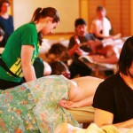 Focused Student Practicing Massage at Ashland Institute of Massage (AIM)