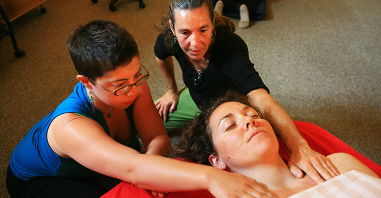 Laureen Demonstrating Massage Technique to Student at Ashland Institute of Massage (AIM)