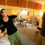 Laureen Demonstrating Massage Technique with Arm in Air at Ashland Institute of Massage (AIM)