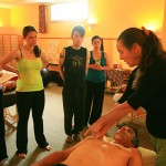 Laureen Demonstrating to Group of Students at Ashland Institute of Massage (AIM)